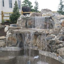 Custom waterfall installed by Rutgers Landscape